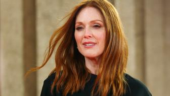 Actress Julianne Moore arrives on the red carpet for the screening of the movie 'Maggie's Plan', during the 66th Berlinale International Film Festival, in Berlin, Germany February 15, 2016.     REUTERS/Hannibal Hanschke