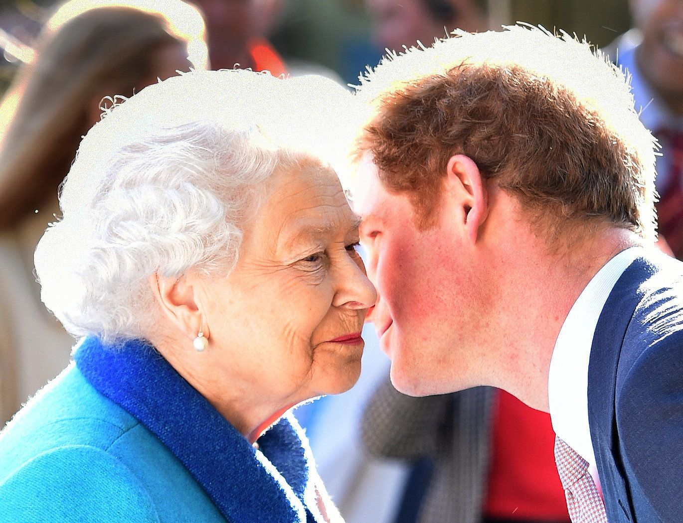 Queen Elizabeth II greets her grandson Prince Harry at the Sentebale Garden as they attend the annual Chelsea Flower show at Royal Hospital Chelsea in London.