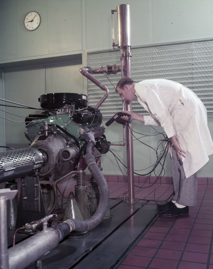 An employee checking engine timing at the Ford Dynamometer Building, 1958.