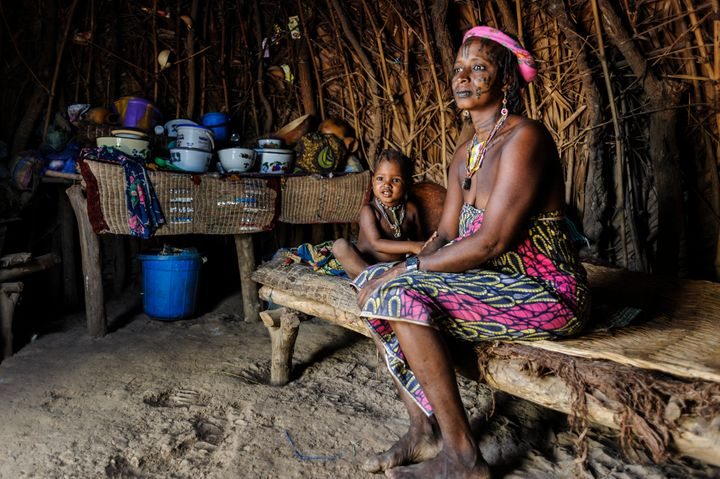 CAMEROON - 2015/04/13: Mbororo woman with her child inside her hut . (Photo by Jorge Fernández/LightRocket via Getty I