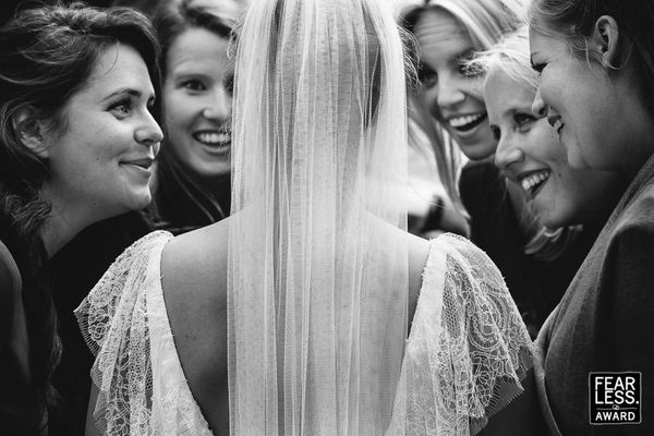 """""""Who could resist all these genuinely happy faces, beaming at the bride? This photographer knew we didn't even need to see th"""
