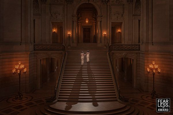 """""""As they climb the majestic staircase in this grand hall, the brides are quite petite in the frame. By adding backlighting, h"""