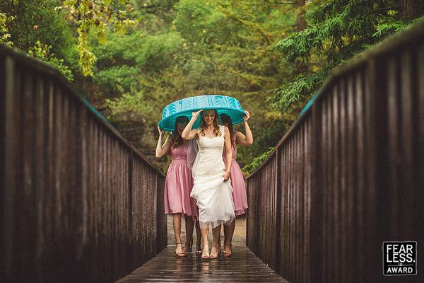 """""""You've got to love a bride who goes with the flow—and admire the photographer who is right there with her! The strong"""