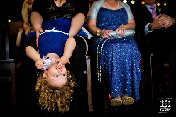 """""""In their matching blue dresses, these ladies of different generations are a perfect match. The photographer captured the lit"""