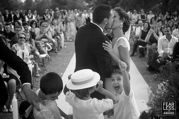 """""""Sure, the photographer could have zoomed in and gotten a traditional view of the first kiss—but the reaction of this f"""