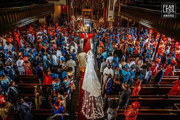 """""""The vibrant attire of this crowd of wedding guests certainly deserved a big, bold, wide-angle photograph. Shooting down from"""