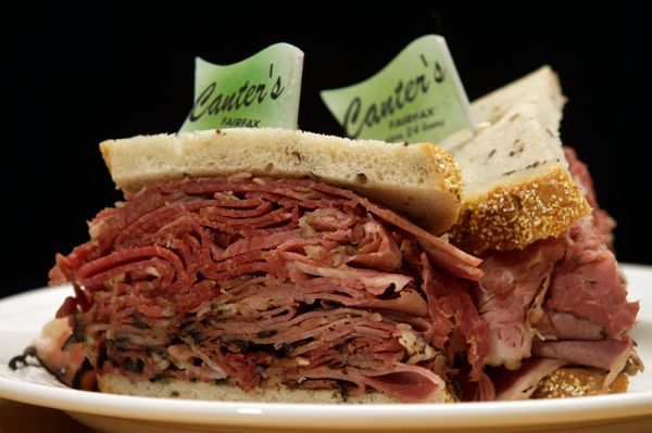 """<a href=""""https://foursquare.com/v/canters-delicatessen/3fd66200f964a520a0ee1ee3"""" target=""""_blank"""">The pastrami sandwich comes"""