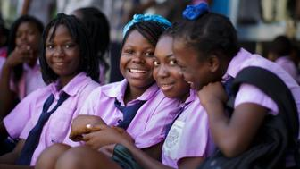 Beira, Mozambique - September 29: Students in school uniforms posing for a photo on September 29, 2015 in Beira, Mozambique. (Photo by Thomas Trutschel/Photothek via Getty Images)