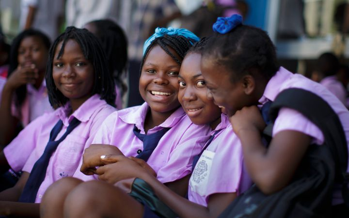 Students in school uniforms pose for a photo in Beira, Mozambique.