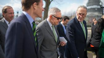 UNITED STATES - MARCH 17: From left, Sens. Tom Udall, D-N.M., Richard Blumenthal, D-Conn., Senate Minority Leader Harry Reid, D-Nev., and Charles Schumer, D-N.Y., make their way to a news conference at the Supreme Court to encourage a hearing and vote on justice nominee Merrick Garland, March 17, 2016. (Photo By Tom Williams/CQ Roll Call)