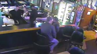 Surveillance footage of a robbery at this Billings, Montana, bar shows a couple so busy making out they don't notice a crime is going on.