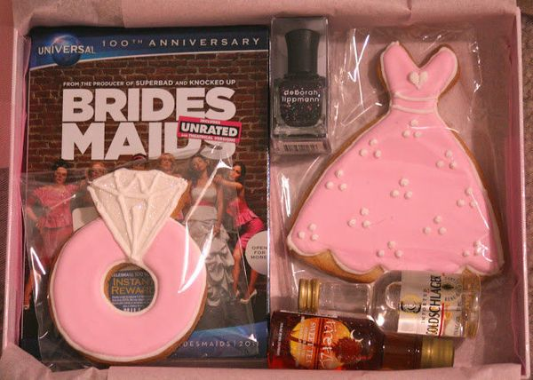 """Deliver abe-my-bridesmaid box with all the essentials --""""Bridesmaids"""" the movie, booze and some sweet treats."""