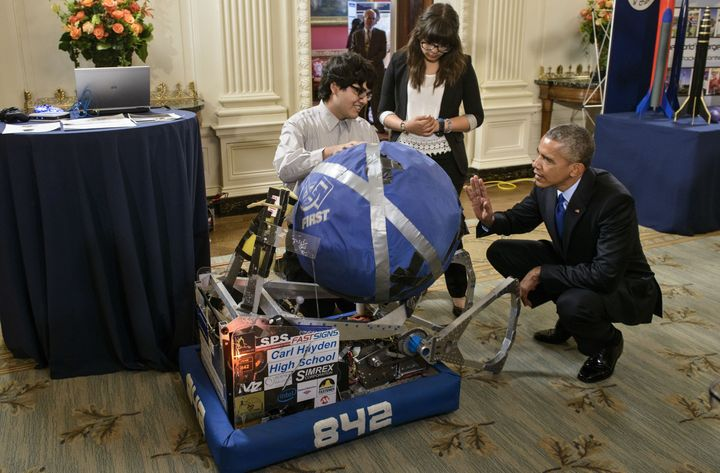 Sergio Corral (left) and Isela Martinez (center), both of Phoenix, Arizona, explained their robot to Obama during the 2015 White House Science Fair.