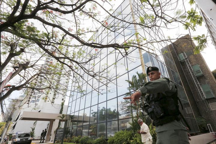 A police officer gestures as he stands guard outside the Mossack Fonseca law firm office in Panama City April 12, 2016.
