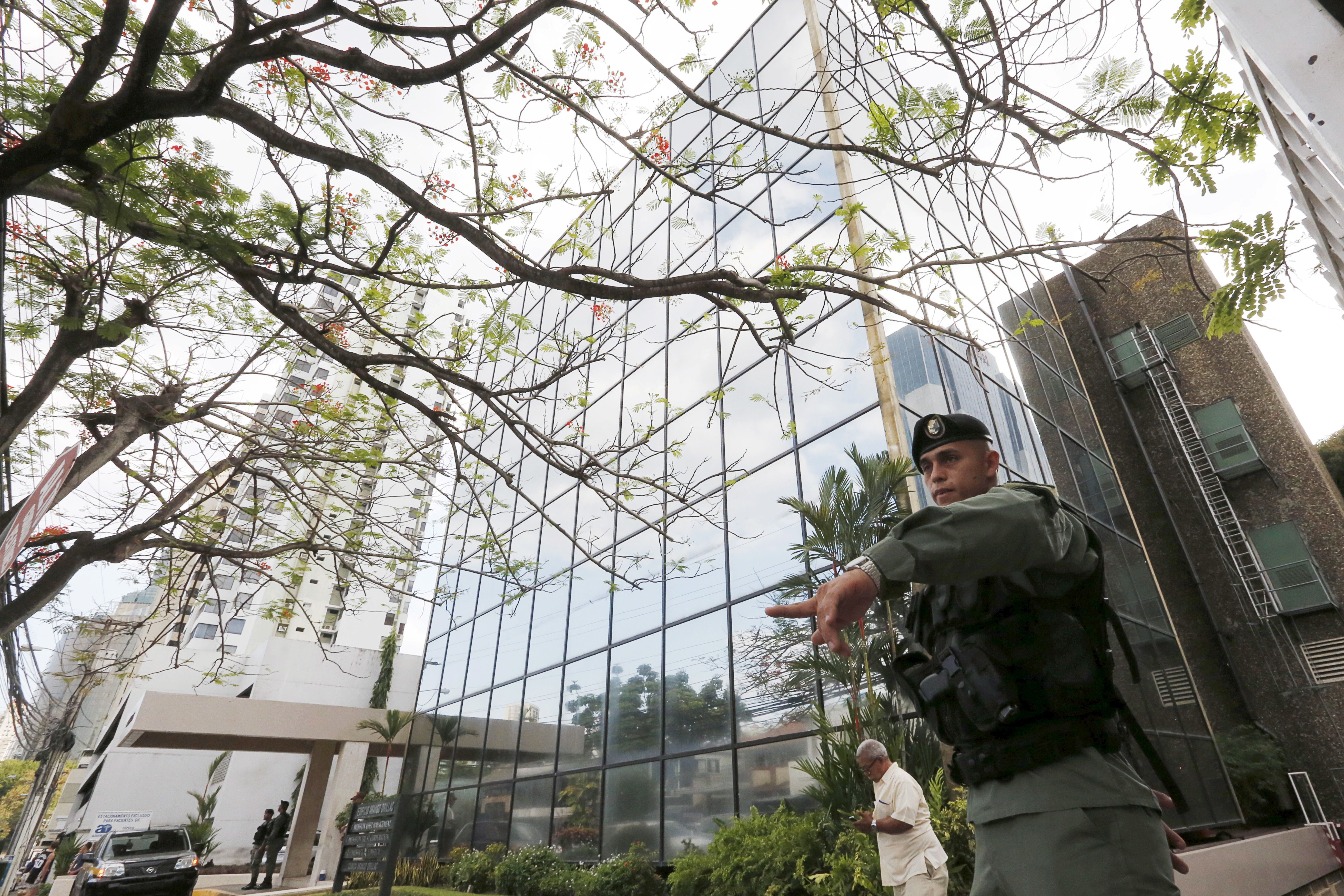 A police officer gestures as he stands guard outside the Mossack Fonseca law firm office in Panama City April 12, 2016. REUTERS/Carlos Jasso