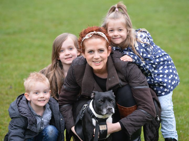 Lisa Johnson with her dog Marley and children Thea (7), Effy (5) and Freddie (3)