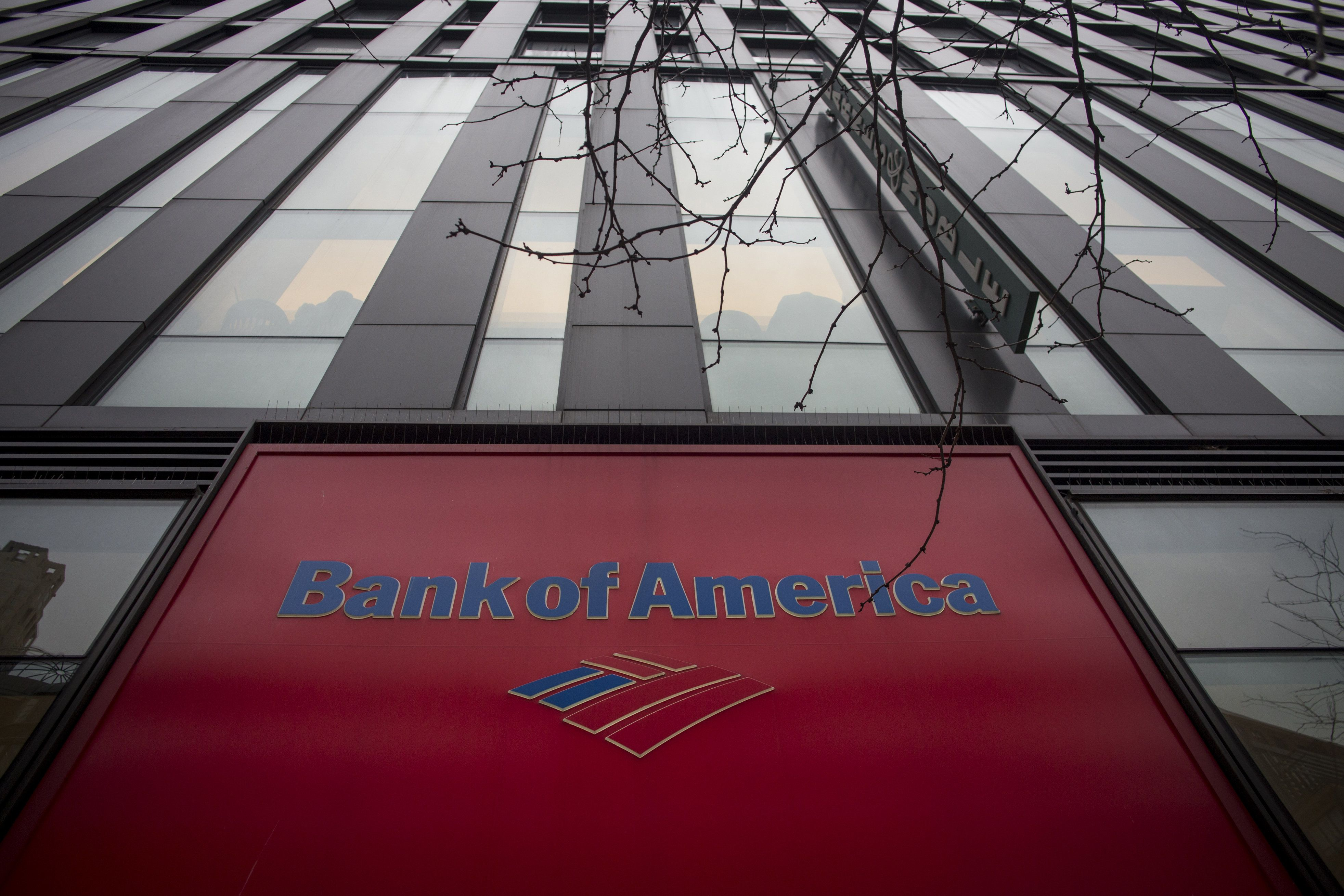 Bank of America Corp. signage is displayed on the company's branch in New York, U.S., on Friday, Jan. 12, 2016. Bank of America is scheduled to report earnings data on January 19. Photographer: John Taggart/Bloomberg via Getty Images