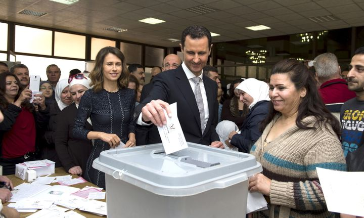 Syrians took part in parliamentary elections in what voters called a show of support for President Bashar al Assad and w