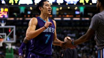BOSTON, MASSACHUSETTS - APRIL 11: Jeremy Lin #7 of the Charlotte Hornets celebrates after a play in the third quarter against the Boston Celtics at TD Garden on April 11, 2016 in Boston, Massachusetts. NOTE TO USER: User expressly acknowledges and agrees that, by downloading and/or using this photograph, user is consenting to the terms and conditions of the Getty Images License Agreement.  (Photo by Mike Lawrie/Getty Images)