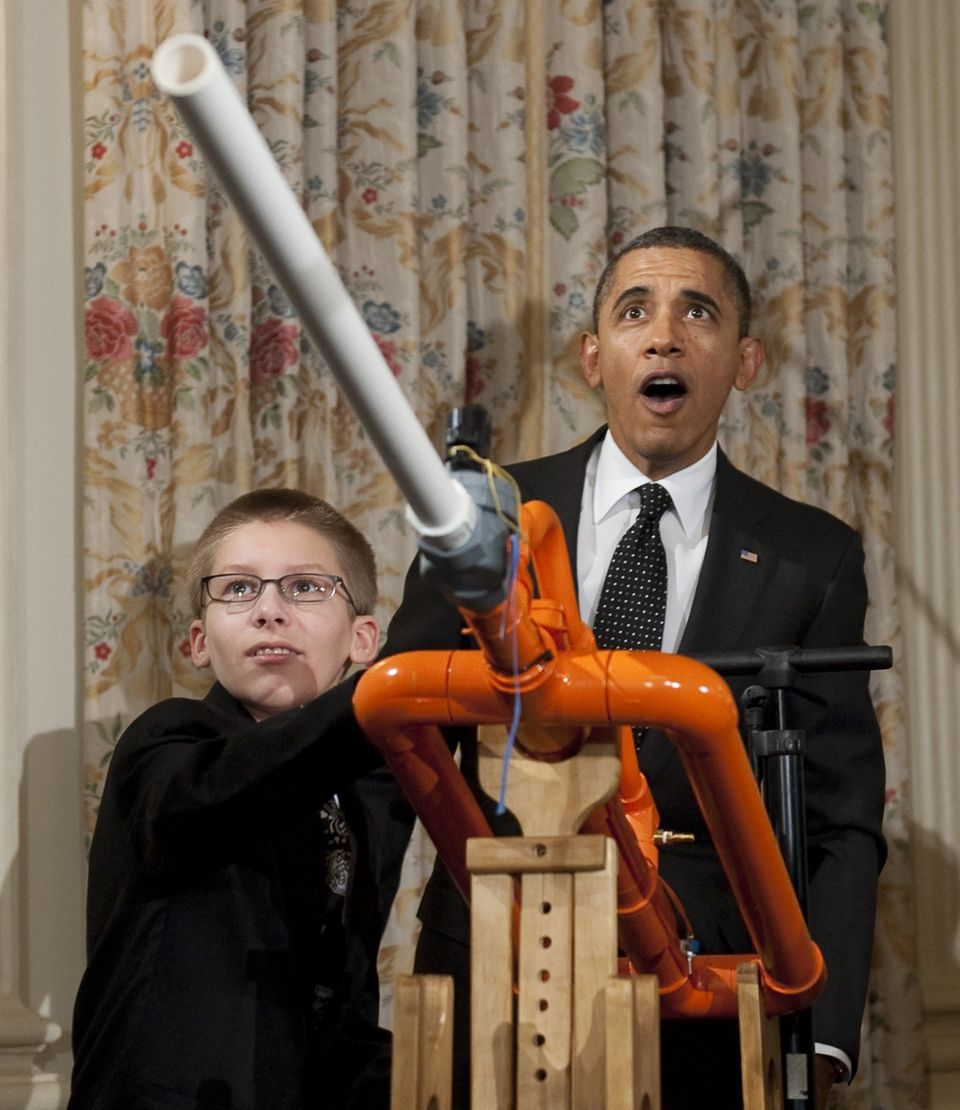 US President Barack Obama reacts as 14-year-old Joey Hudy of Phoenix, Arizona, launches a marshmallow from Hudy's 'Extreme Ma