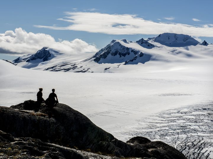 A young couple is seen overlooking Alaska's Harding Glacier Field in the Kenai Peninsula where a pair of skiers recently beca