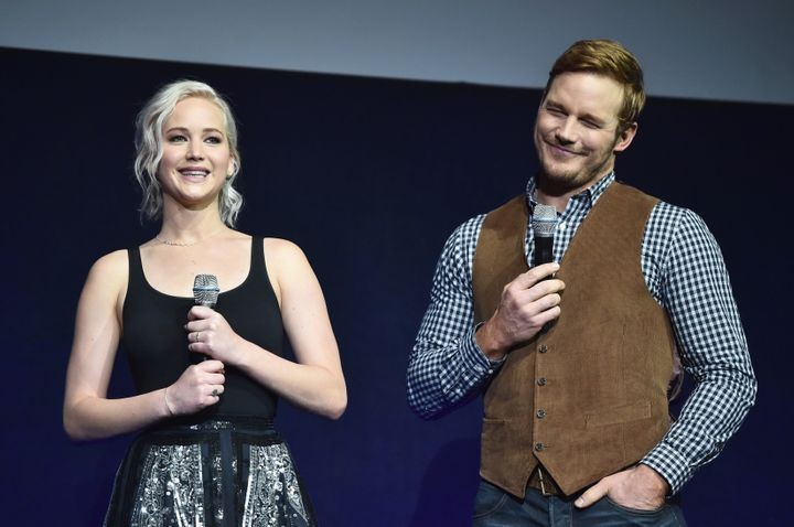 Actress Jennifer Lawrence (L) and actor Chris Pratt speak onstage during CinemaCon 2016.