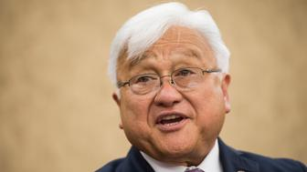 UNITED STATES - JUNE 10: Rep. Mike Honda, D-Calif., holds a news conference with Vietnam veterans and their families to introduce the 'Toxic Exposure Research and Family Support Act of 2014' on Tuesday, June 10, 2014. (Photo By Bill Clark/CQ Roll Call)