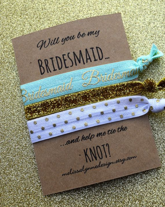 Make your bridesmaid proposition with some sparkly hair ties.