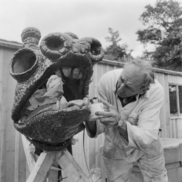A fiberglass model of the Loch Ness monster is seen being created for