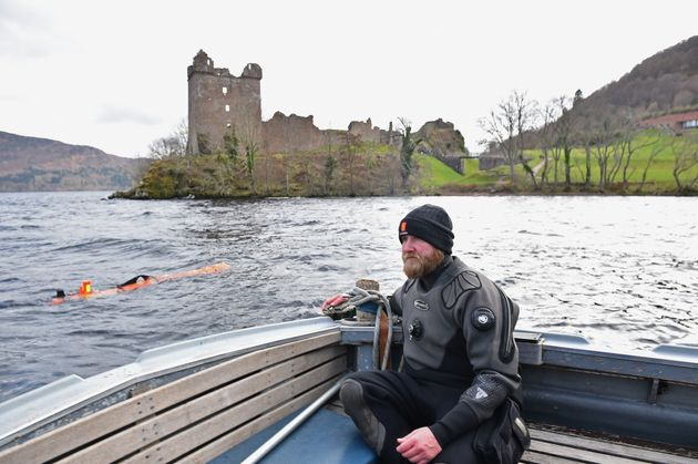 Engineer John Haig monitors the robot as it rests in Loch Ness' water in Drumnadrochit, Scotland, on