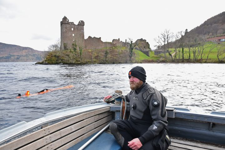 Engineer John Haig monitors the robot as it rests in Loch Ness' water in Drumnadrochit, Scotland, on Wednesday.