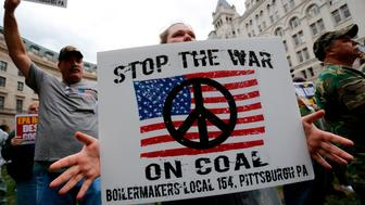 Jenna McFetridge (C) of Pittsburgh joins with members of United Mine Workers of America as they hold a rally outside the U.S. Environmental Protection Agency headquarters in Washington October 7, 2014. The coal miner's union members rallied against proposed EPA (Environmental Protection Agency) Clean Power Plan rules, which the union claims will eliminate thousands of coal industry-related jobs. REUTERS/Jonathan Ernst (UNITED STATES - Tags: POLITICS ENVIRONMENT BUSINESS EMPLOYMENT CIVIL UNREST ENERGY)
