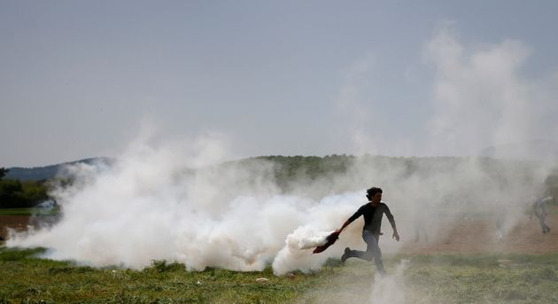 Macedonian police fired tear gas Wednesday after about 50 people tried to pull down the razor...