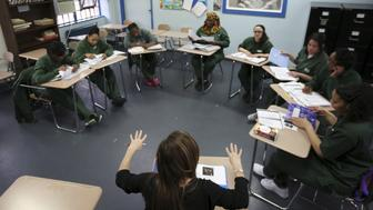 """Inmates study during their class at the Taconic Correctional Facility in Bedford Hills, New York April 8, 2016. Inmates at Taconic Correctional Facility, a medium security women's prison in suburban Bedford Hills near New York City, are reading the classic works of Homer, Euripides and Virgil. The Columbia University course, organised by the non-profit Hudson Link for Higher Education in Prison, aims to boost employment for convicts after release and reduce rates of reoffending. REUTERS/Carlo Allegri SEARCH """"TACONIC ALLEGRI"""" FOR THIS STORY. SEARCH """"THE WIDER IMAGE"""" FOR ALL STORIES"""