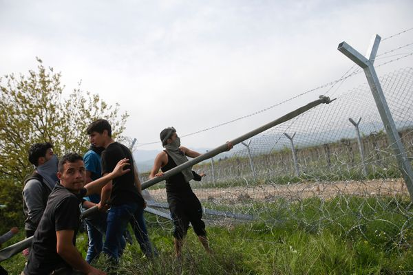 Men tried to break a border security fence during the scuffles. Around 300 people were injured in a similar attempt to g