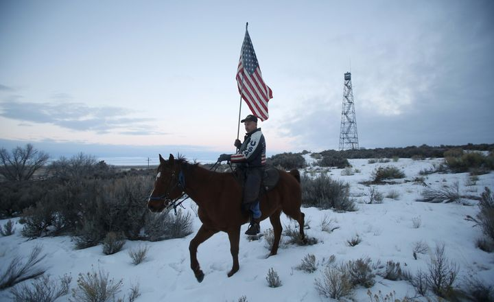 Duane Ehmer rode his horse and carried a flag at the Oregon occupation.