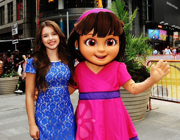 Fatima Ptacek poses with 'Dora' outside the closing bell at the NASDAQ MarketSite in 2014.