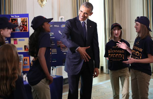 U.S. President Barack Obama listens to Girl Scout Troop #1484 explain their science project while touring exhibits at the Whi