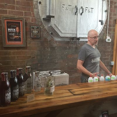 George Smith, founder and CEO, at Copper Barrel Distillery in North Wilkesboro, North Carolina, at his tasting bar. The distillery celebrates its first anniversary April 16.