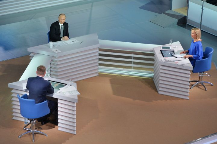 Rossiya TV Channel journalist Yevgeny Rozhkov, Russia's President Vladimir Putin and Channel One news anchor Valeria Korablev