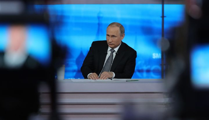 Russian President Vladimir Putin listens to a question during his annual televised call-in show in central Moscow on April 14