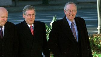 Senator Mitch McConnell (R-Ky) (C) and his lawyers, former independent counsel in the Whitewater investigation Ken Starr (R) and Floyd Abrams (L), walk up to the U.S. District Courthouse in Washington, December 4, 2002. McConnell and his lawyers will be presenting oral arguments in his case against the Federal Election Committee (FEC) over the constitutionality of a new campaign finance law. REUTERS/Brendan McDermid  BM/HB