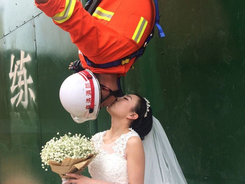 A fireman and his wife pose for wedding photos at the fire station on April 9, 2016 in Shangluo, Shaanxi Province of China. 2