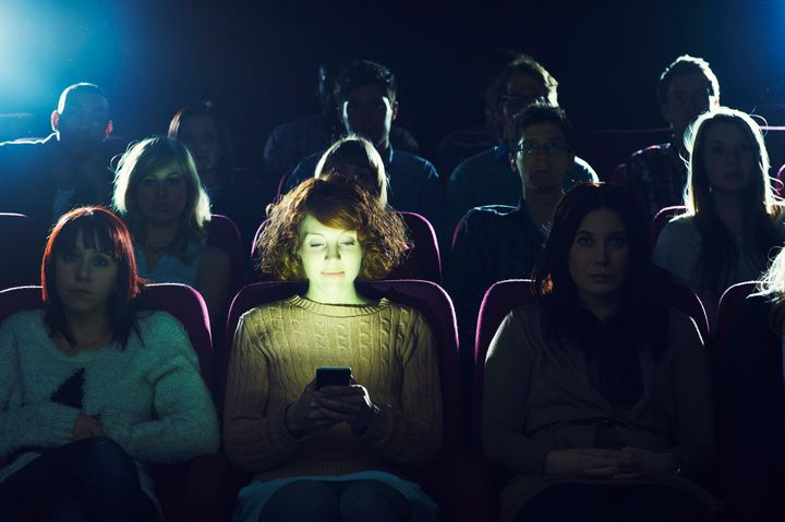 """We're going to have to figure out a way to do it,"" AMC CEO Adam Aron said about permitting texting in the movies."