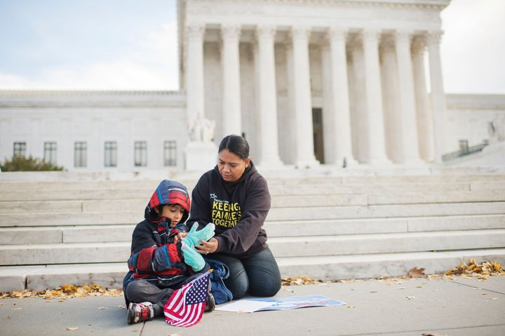 Another immigrant, Rosario Reyes, originally from El Salvador, and her 7-year-old son Victor attend a December press conferen