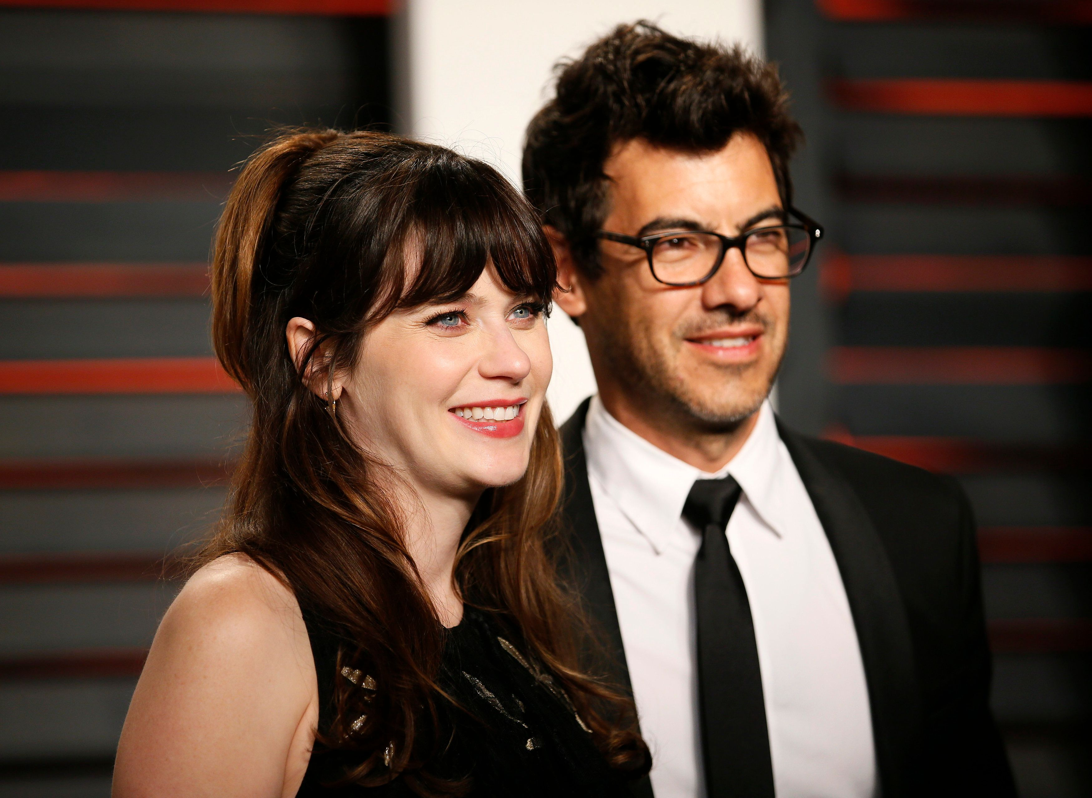 Actress Zooey Deschanel and husband Jacob Pechenik arrive at the Vanity Fair Oscar Party in Beverly Hills, California February 28, 2016.  REUTERS/Danny Moloshok
