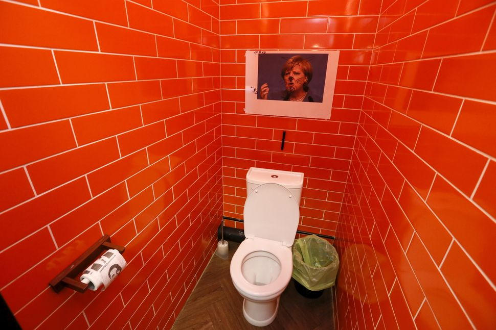 Guests can look at a portrait of the German chancellor in the bathroom.