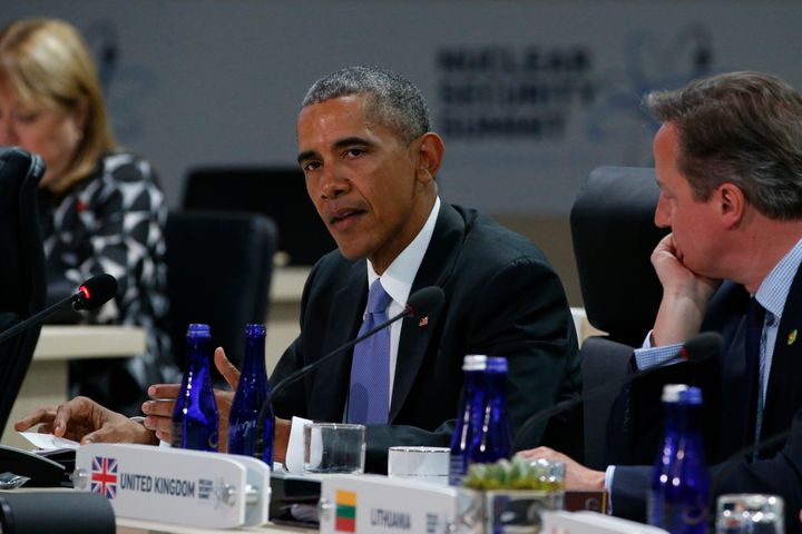U.S. President Barack Obama, sitting with Britain's Prime Minister David Cameron, delivers remarks to start the second and fi