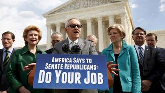 Standing in front of the U.S. Supreme Court, Senate Democratic leader Harry Reid (C) calls for Senate Republicans to move forward with hearings for Obama's Supreme Court nominee Merrick Garland in Washington March 17, 2016.  REUTERS/Kevin Lamarque       TPX IMAGES OF THE DAY