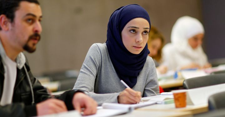 Migrants who worked as teachers in their home countries takes part in a programme to educate them for German schools at the U